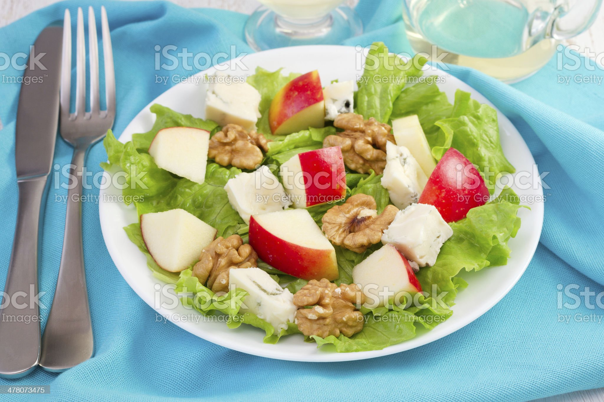 cheese salad with walnut and apple on the white plate royalty-free stock photo