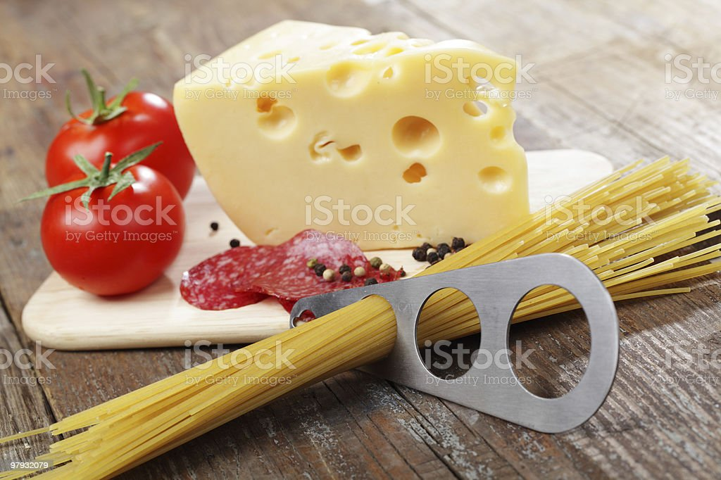Cheese, salami, and raw spaghetti royalty-free stock photo