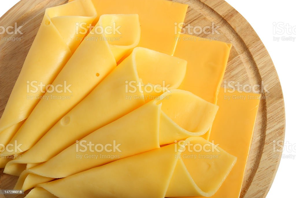 Cheese slices laid out nicely on a wooden party platter royalty-free stock photo