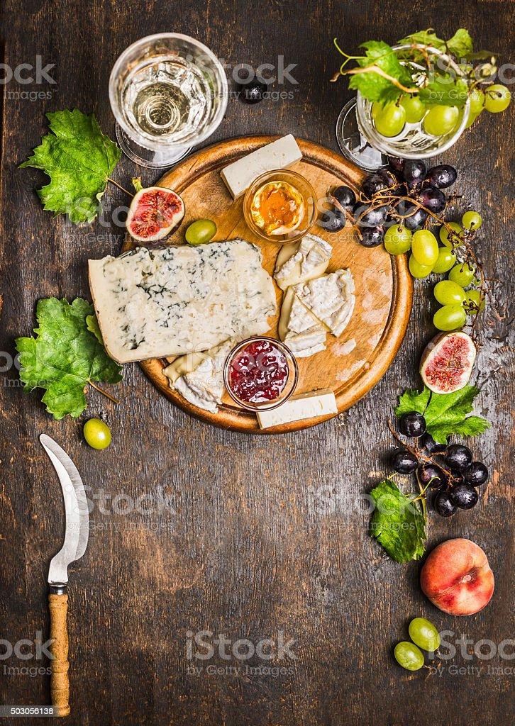 cheese snack Gorgonzola Camembert wine honey knife cheese grapes stock photo