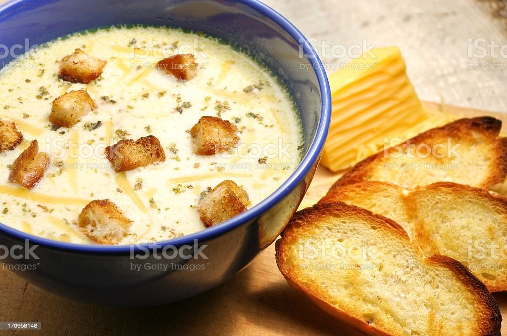 Cheese soup in blue ceramic bowl with toasted bread royalty-free stock photo