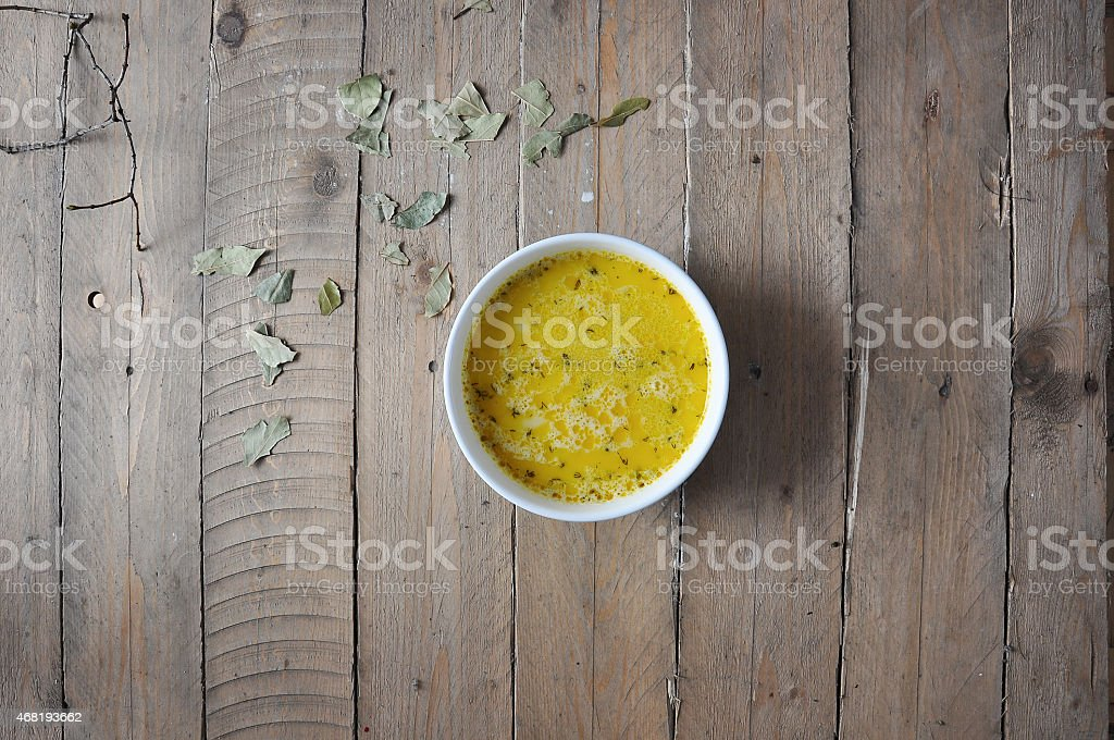 Cheese soup with spices on wooden stock photo