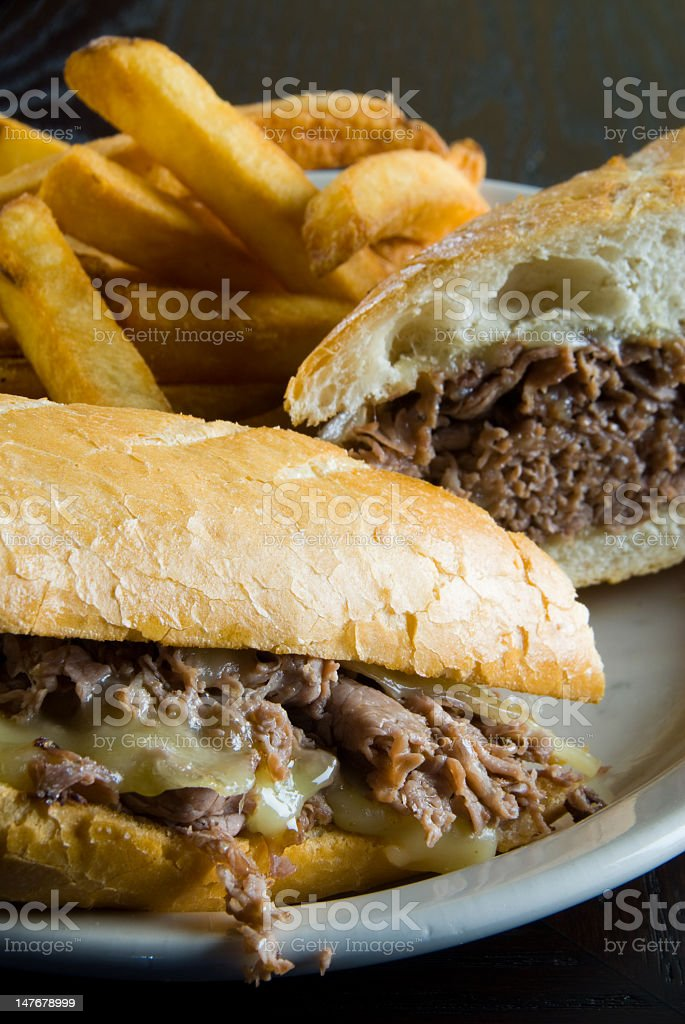 Cheese steak sandwich with French fries on plate royalty-free stock photo