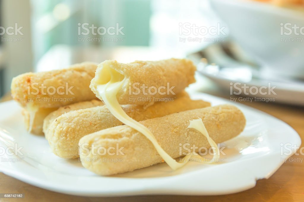 cheese sticks on a plate stock photo