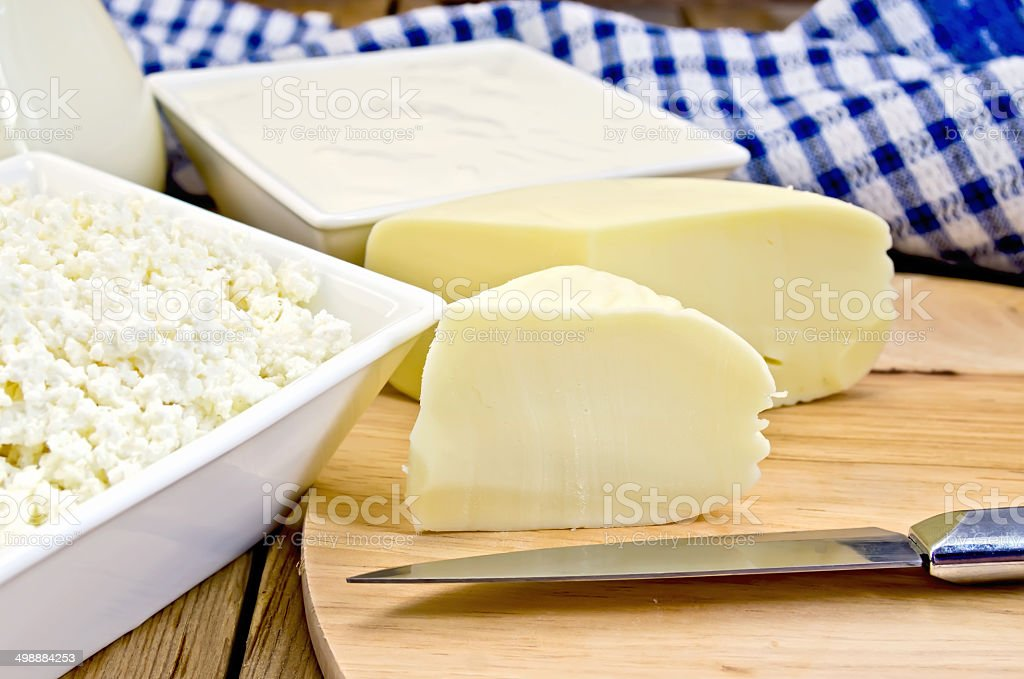 Cheese suluguni with curd and sour cream on board stock photo