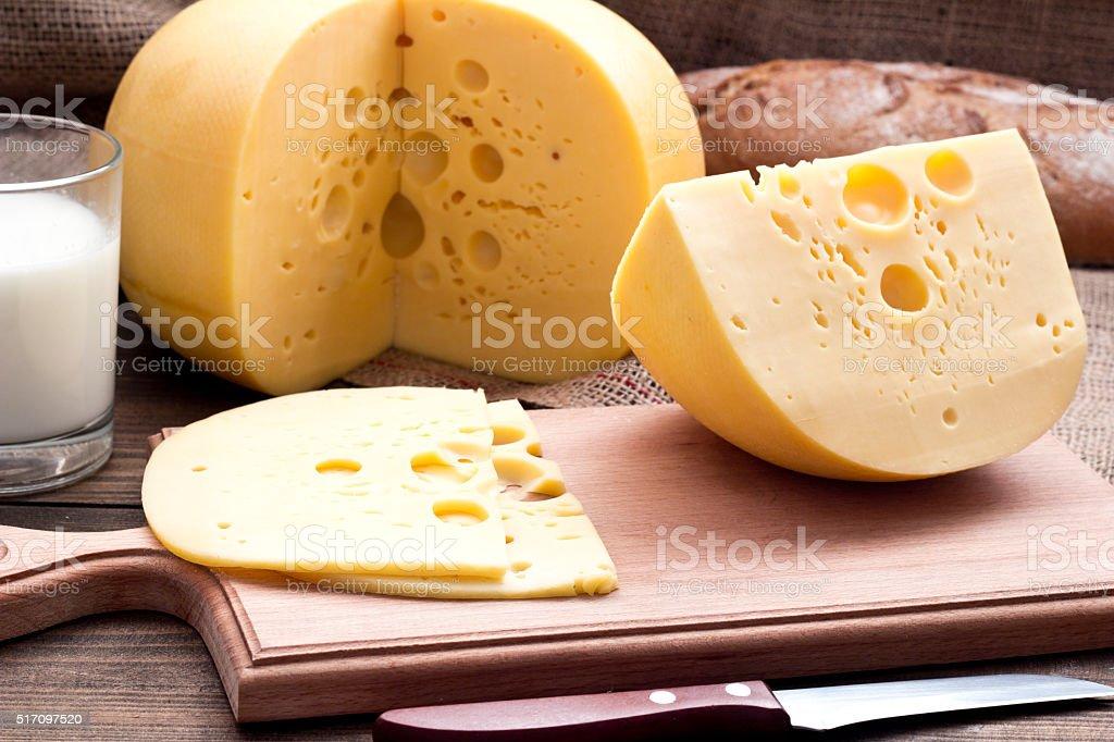 Cheese wheel on wood. Organic food stock photo