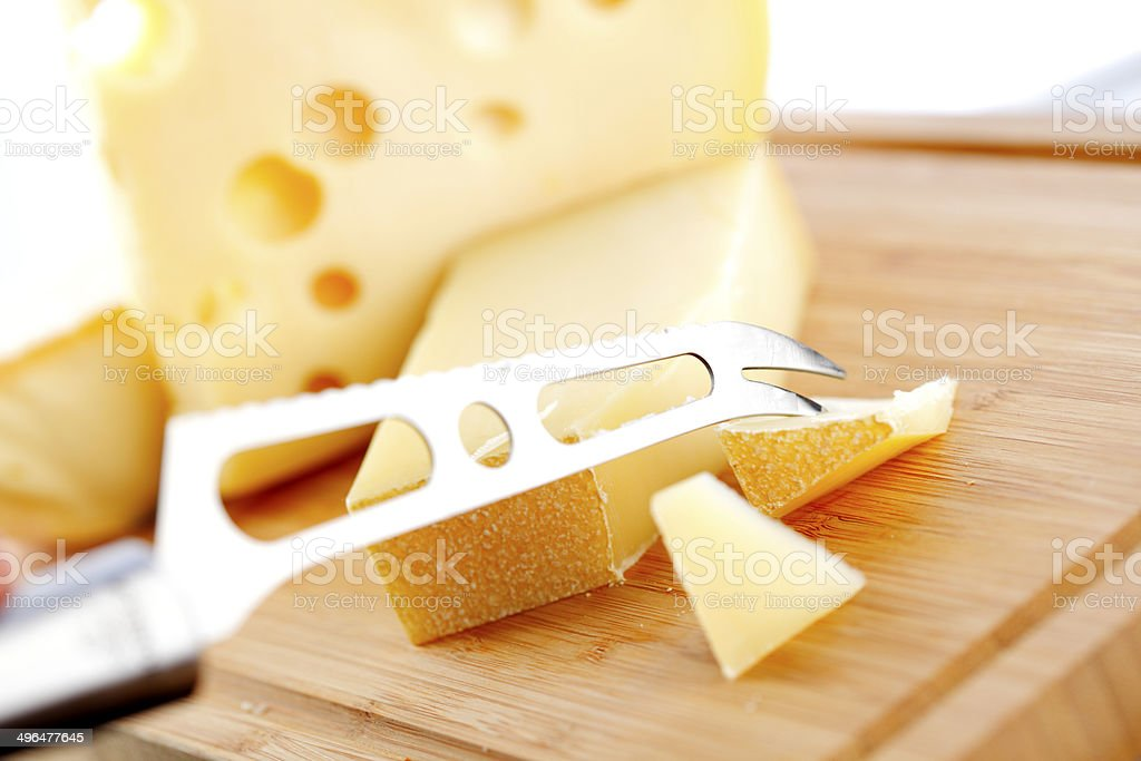 cheese with a cheese knife royalty-free stock photo