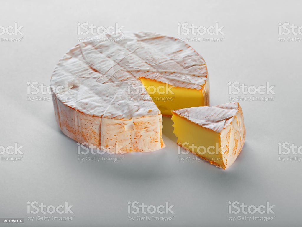 Cheese with a white mould on gray background stock photo