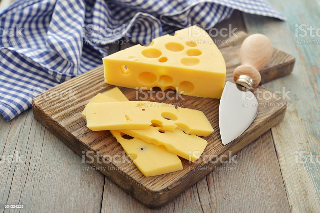 Cheese with big holes stock photo