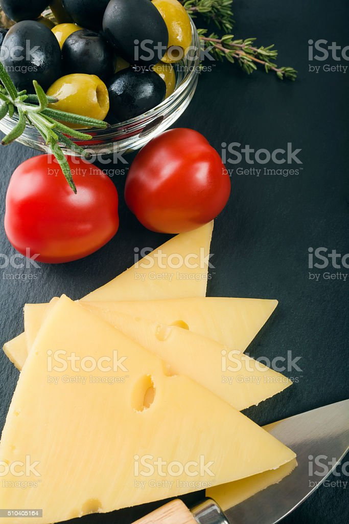 cheese with fresh herbs, olives, tomatoes, stock photo