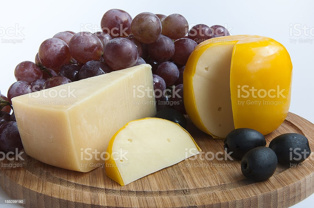 cheese with grapes and olives royalty-free stock photo