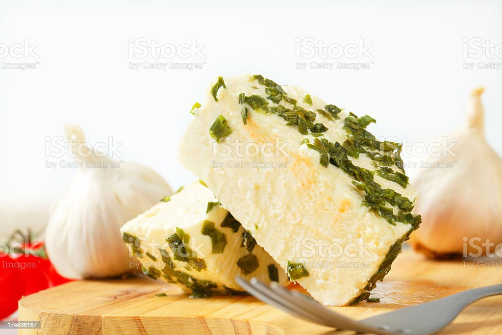 cheese with herbs on cutting board royalty-free stock photo