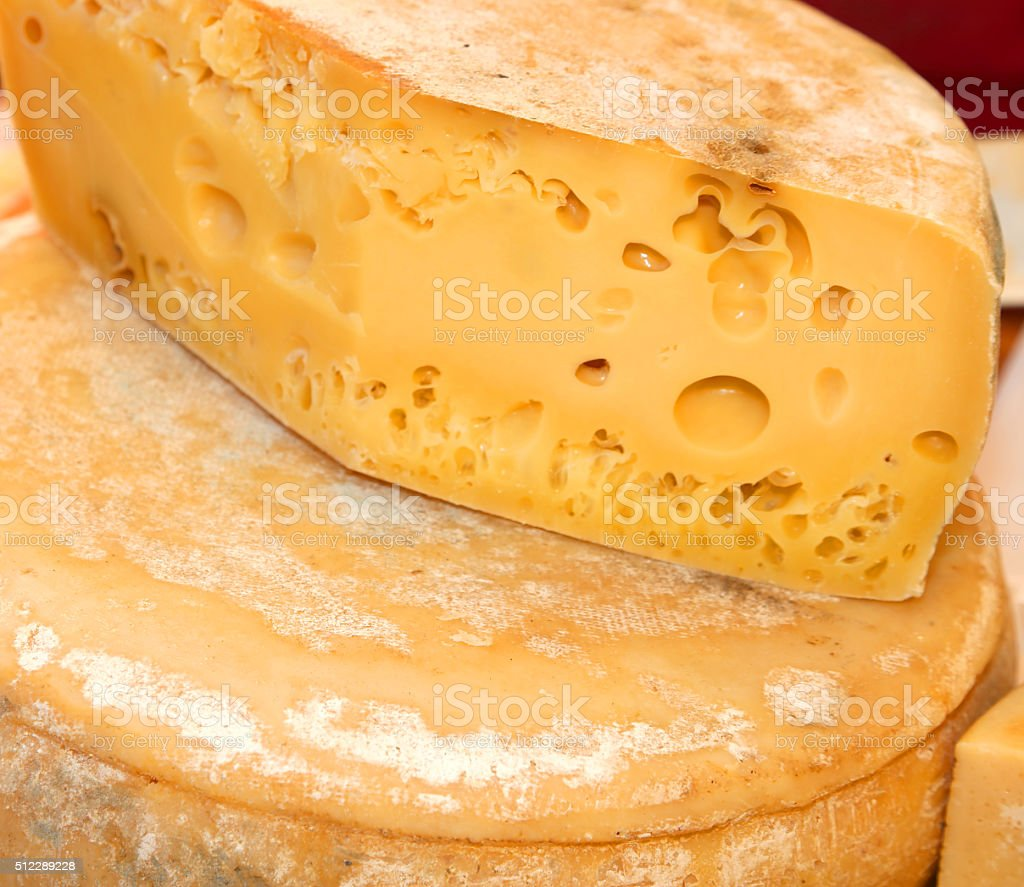 cheese with holes for sale in the market of food stock photo