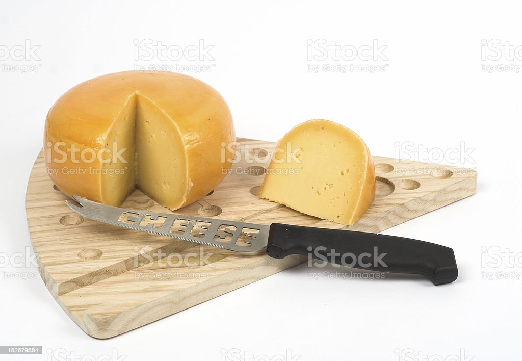 Cheese with knife stock photo