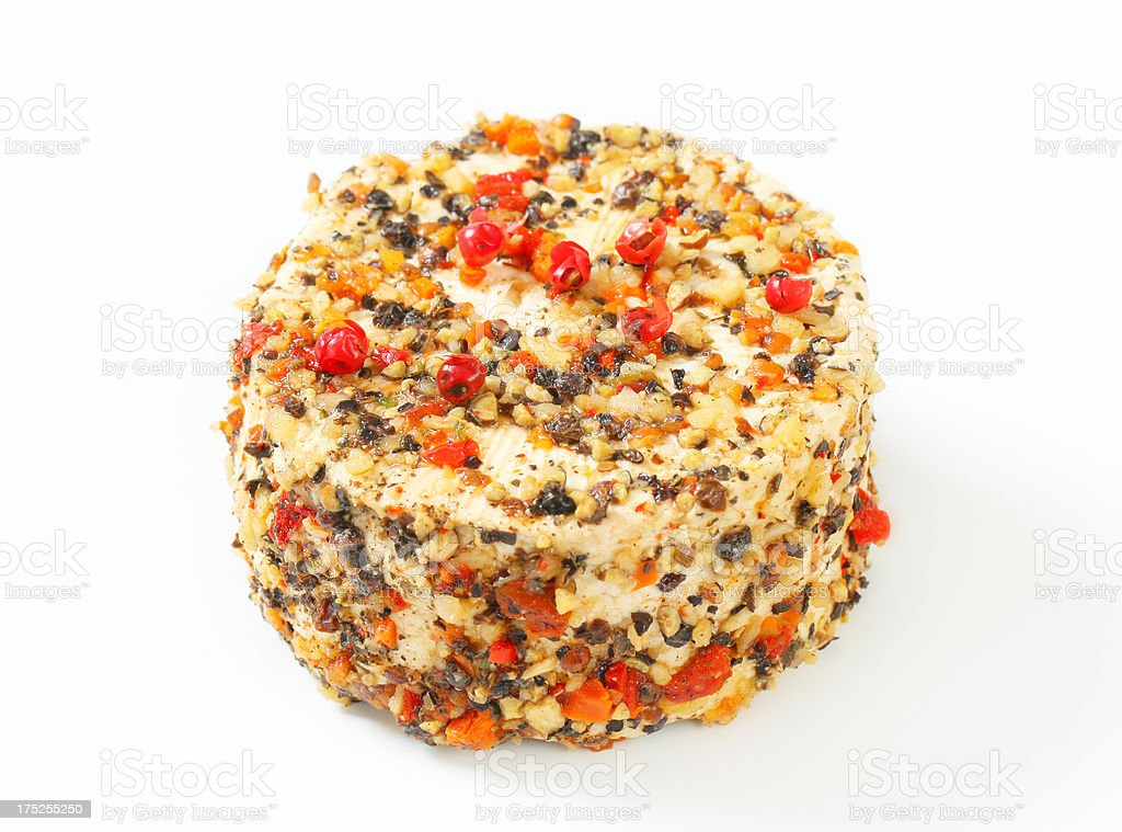 cheese with nut fragments and spices stock photo