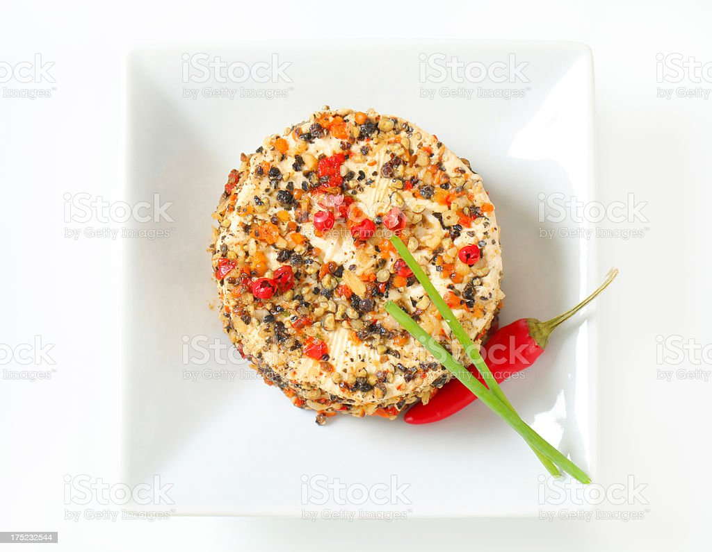 cheese with nut fragments, herbs and spices on plate royalty-free stock photo