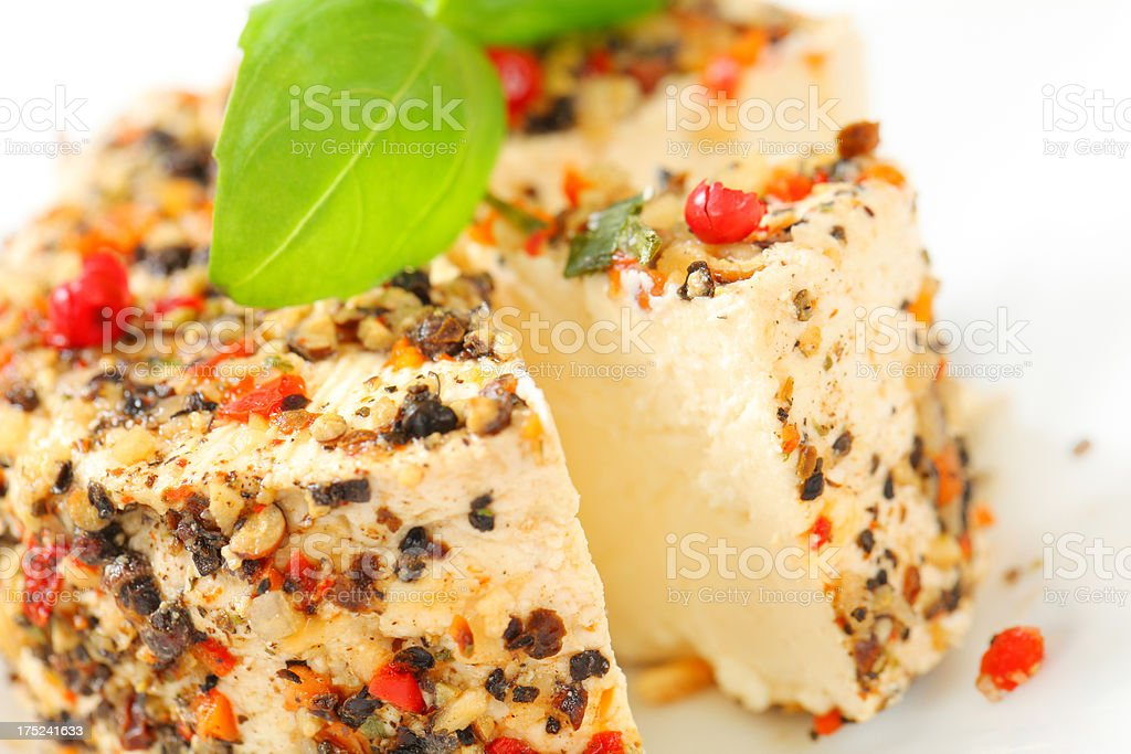 cheese with nut fragments, herbs and spices royalty-free stock photo