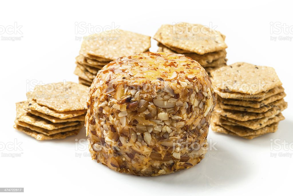 A cheeseball with wheatgerm crackers. stock photo