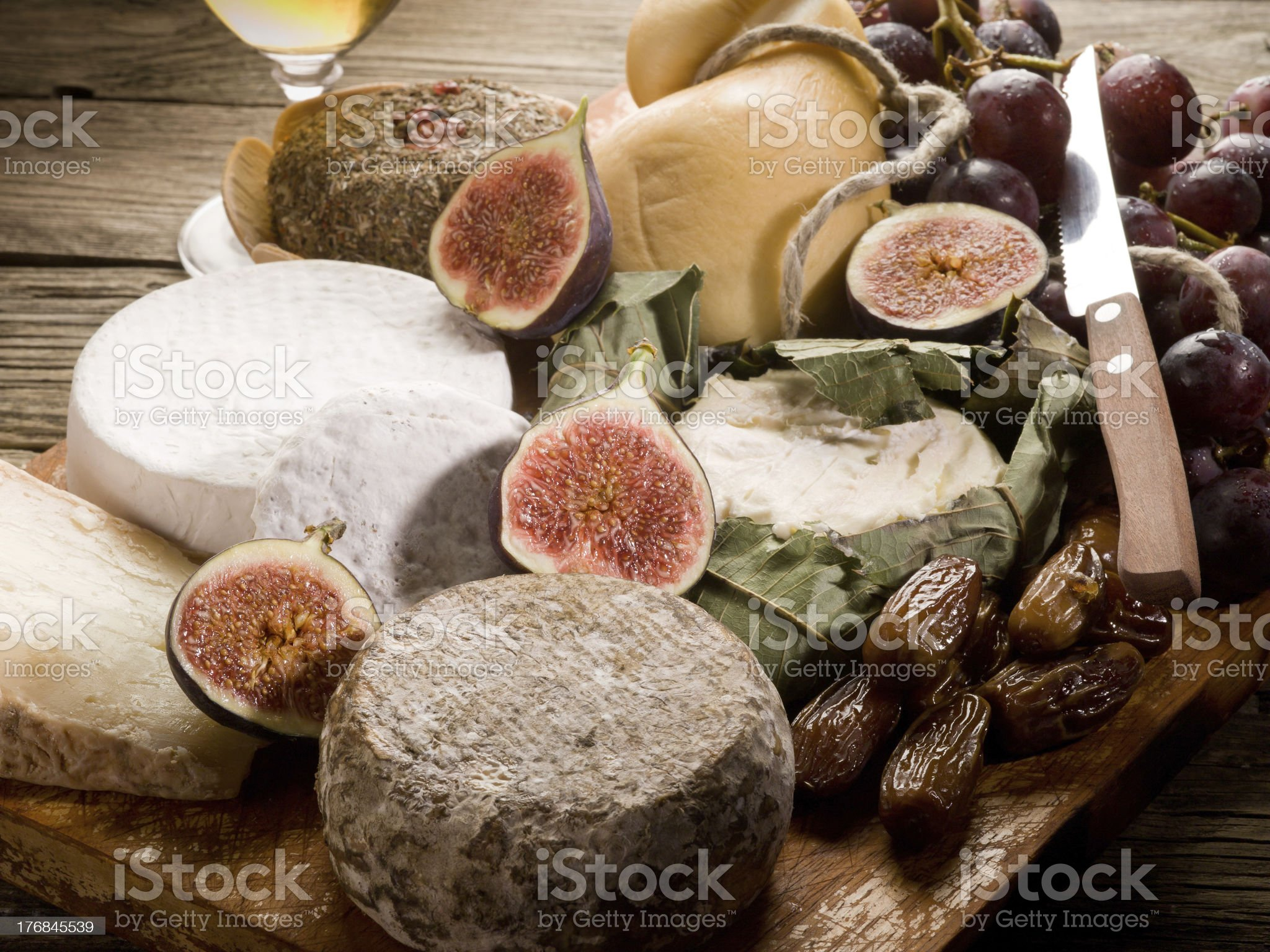 cheeseboard  with an assortment of cheeses and fruits royalty-free stock photo