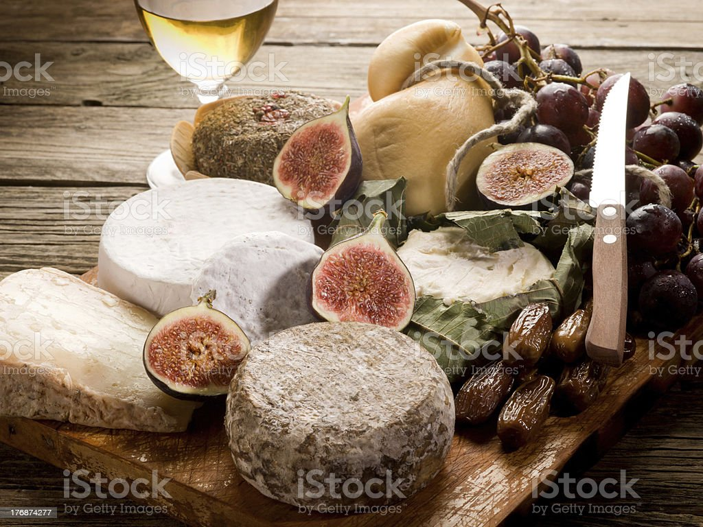 cheeseboard  with an assortment of cheeses and fruits stock photo