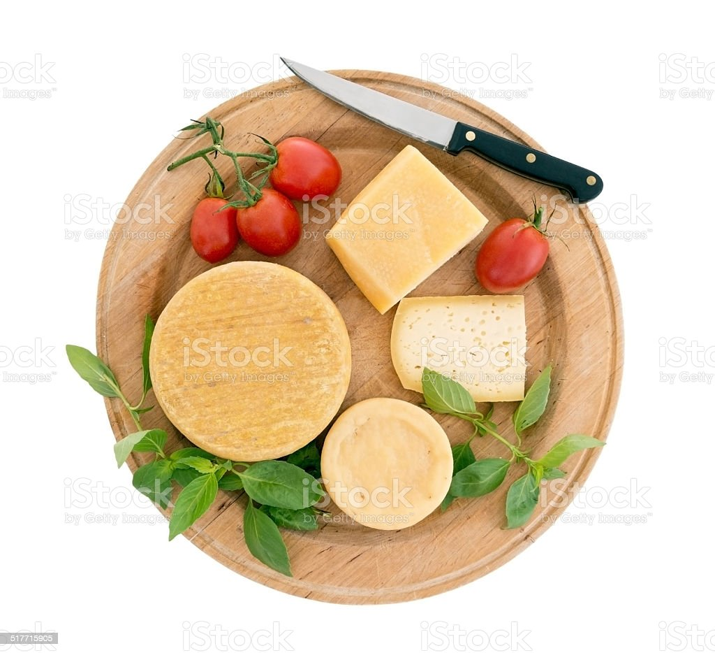 Cheeseboard with tomatoes, herb basil, isolated on white stock photo