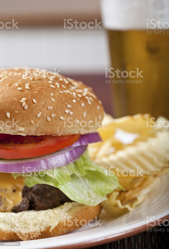 Cheeseburger and beer royalty-free stock photo