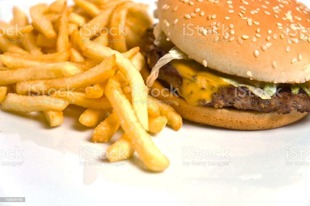 Cheeseburger and french fries royalty-free stock photo