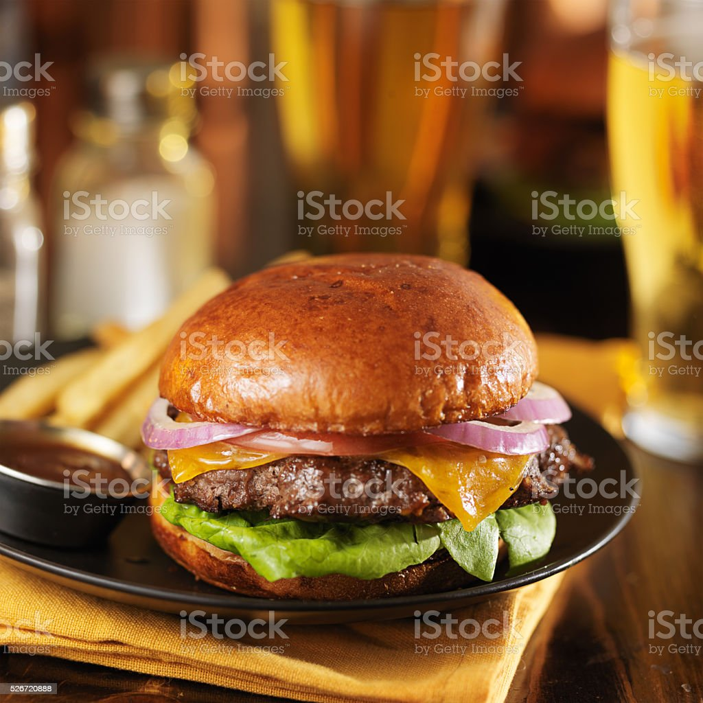 cheeseburger and fries on plate stock photo