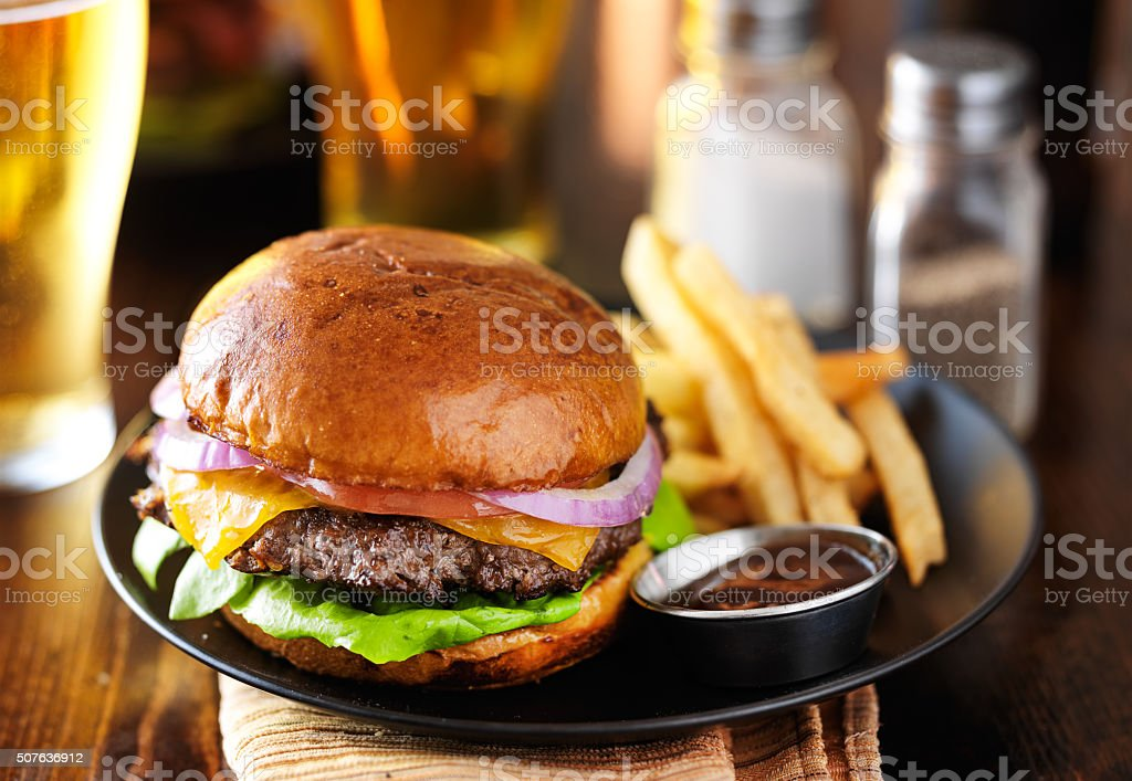 cheeseburger and fries on restaurant table royalty-free stock photo