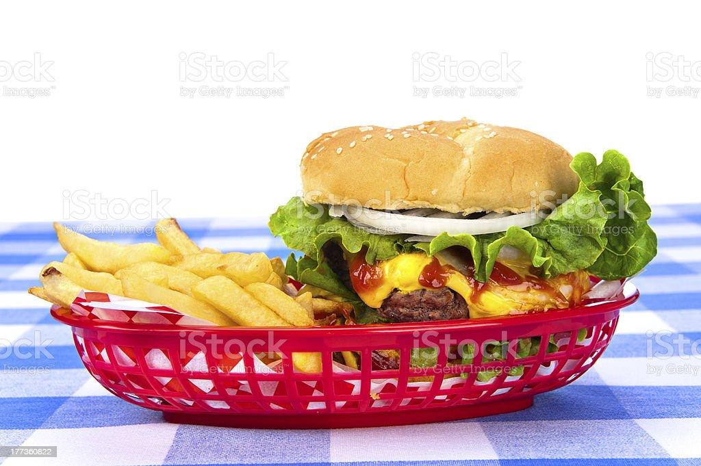 Cheeseburger and fries stock photo
