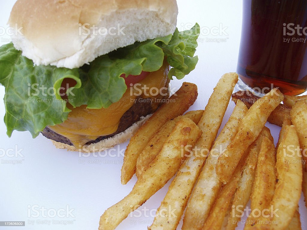 Cheeseburger, fries and a coke - Fast Food Meal royalty-free stock photo