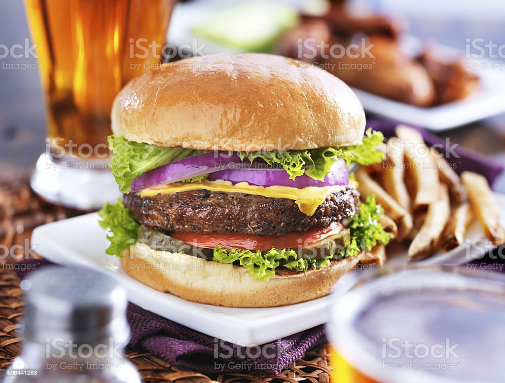 cheeseburger meal with beer and chicken wings stock photo