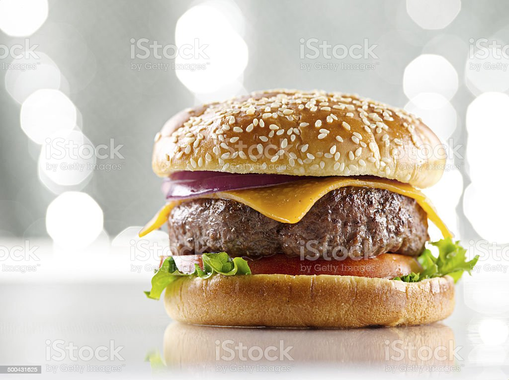 cheeseburger on sparkling background stock photo