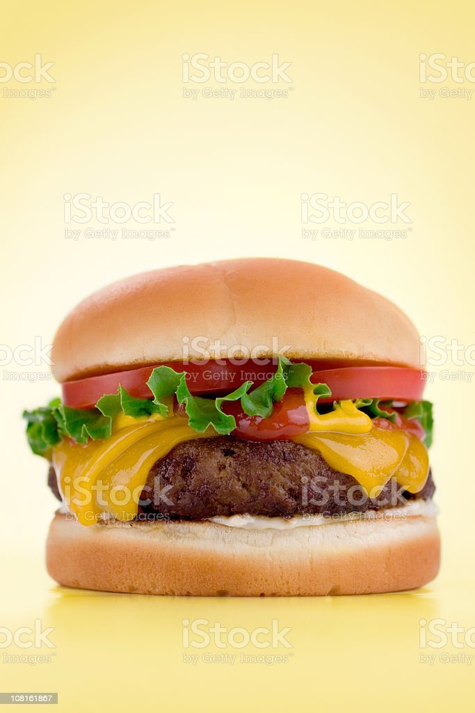 Cheeseburger on yellow background stock photo