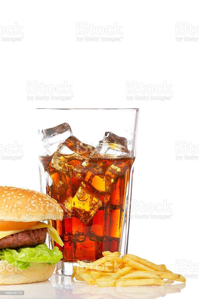 Cheeseburger, soda and french fries royalty-free stock photo