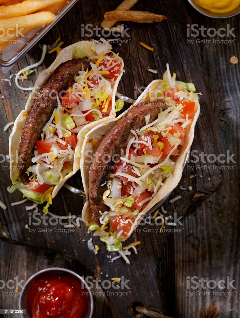 Cheeseburger Tacos with Fries stock photo