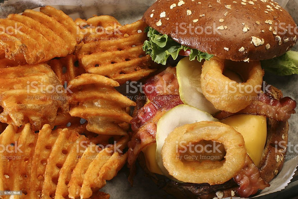 cheeseburger with bacon and waffle fries royalty-free stock photo