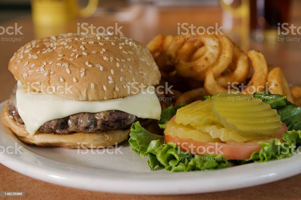 Cheeseburger with Curly Fries stock photo