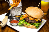 Cheeseburger With French Fries And Glass Of Beer