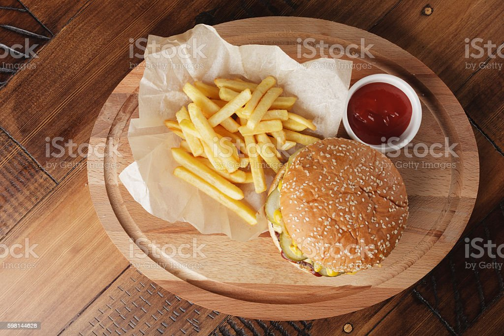 Cheeseburger (burger) with french fries and sauce stock photo