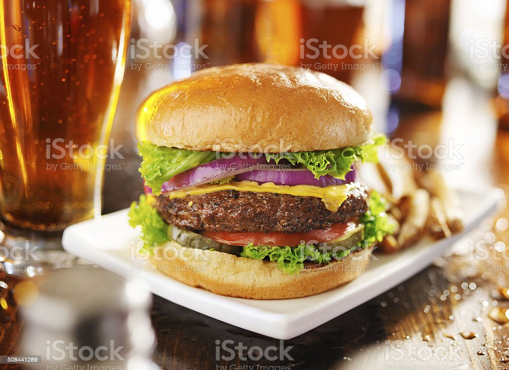 cheeseburger with fries and beer stock photo