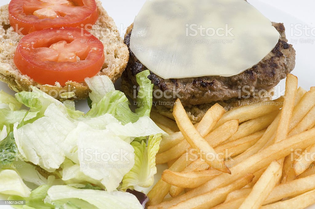 Cheeseburger with fries composition royalty-free stock photo