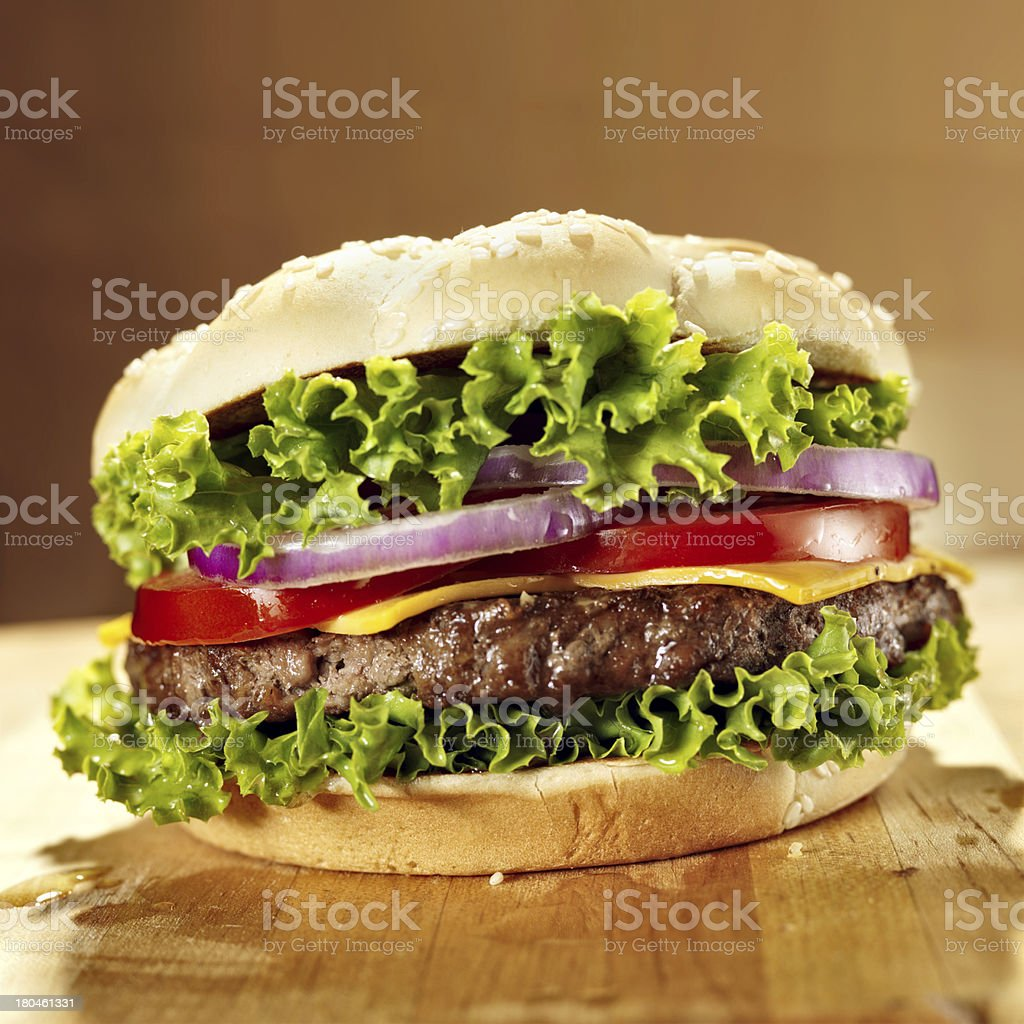 cheeseburger with lettuce tomato and onion. royalty-free stock photo