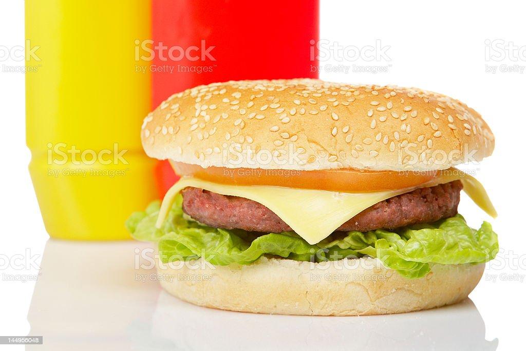 Cheeseburger with mustard and ketchup royalty-free stock photo