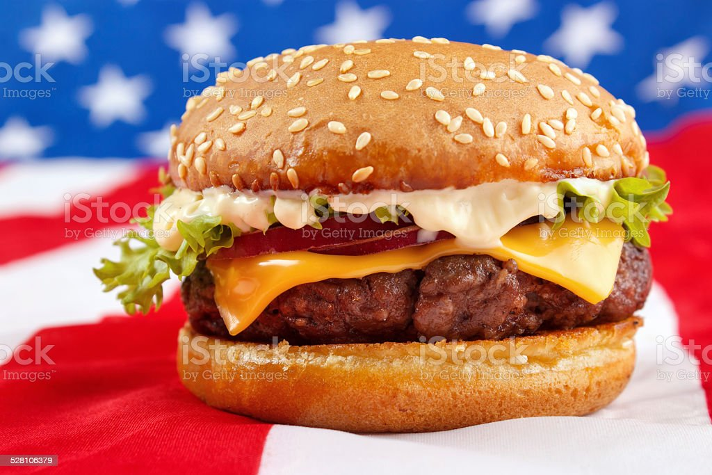 Cheeseburger with USA flag on background royalty-free stock photo