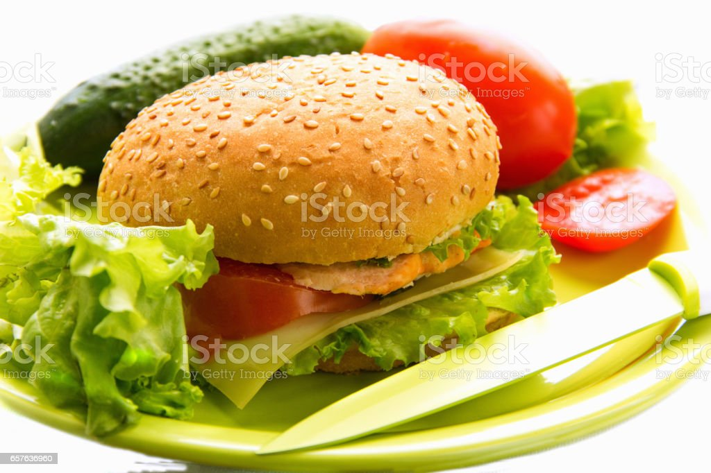 Cheeseburger with vegetables stock photo