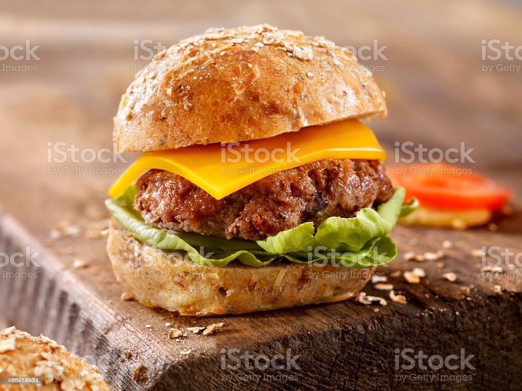 CheeseBurgeron a Rustic Wood Cutting Board stock photo
