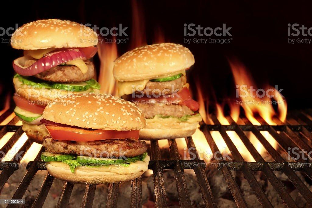 Cheeseburgers Homemade Hamburgers On The Hot Flaming BBQ Grill stock photo