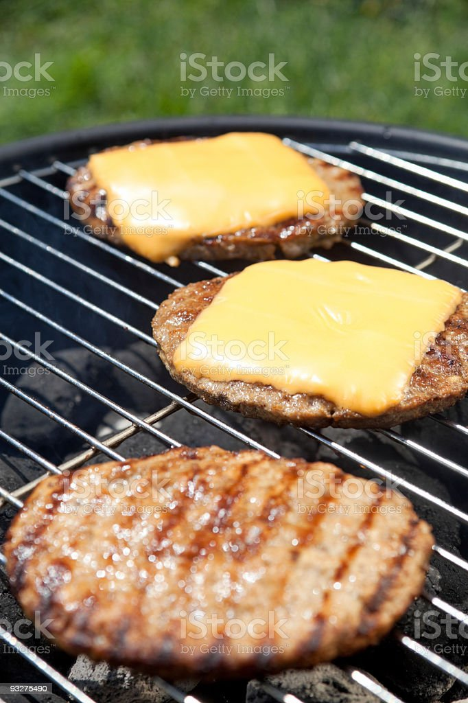 Cheeseburgers on a Grill royalty-free stock photo