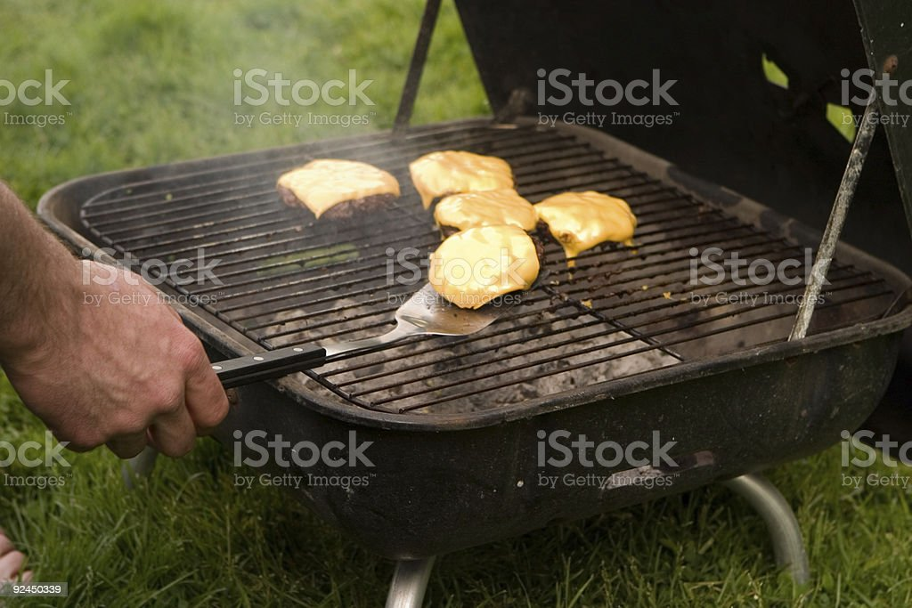 Cheeseburgers on grill 2 stock photo